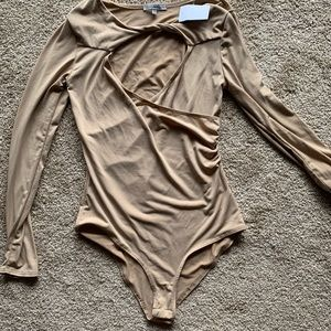 Nude color long sleeve bodysuit.